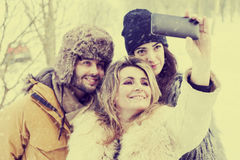 Group of person taking selfie in winter forest. After a big snowfall Royalty Free Stock Photography