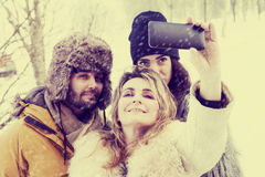 Group of person taking selfie in winter forest Stock Photos