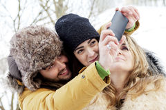 Group of person taking selfie in winter forest Royalty Free Stock Photos