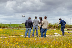 Group of persons making drone training course at La Juliana Aerodrome. Seville, Spain - May 7, 2016: Group of persons making drone training course at La Juliana stock photos