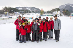 Group photo of 3 generations joyful asian family generations at ski resort. Royalty Free Stock Images