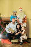 Group Photo of happy family with Santa Claus royalty free stock image