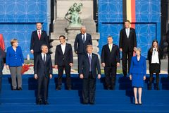 Group photo of participants of the NATO military alliance summit. BRUSSELS, BELGIUM - Jul 11, 2018: Jens Stoltenberg, Donald Trump, Angela Merkel and Teresa May royalty free stock images