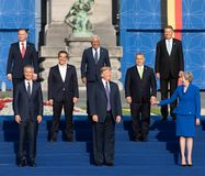 Group photo of participants of the NATO military alliance summit. BRUSSELS, BELGIUM - Jul 11, 2018: Jens Stoltenberg, Donald Trump and Teresa May at the group royalty free stock image