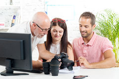 A group of photographers. In their office stock photo