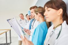 Group of physician apprenticeship students. Group of young physician apprenticeship students in training royalty free stock photo