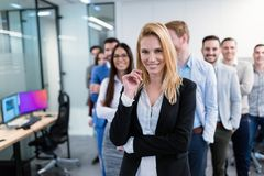 Group picture of business team posing in office stock image