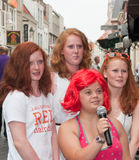 Group picture of four red-haired young ladies. BREDA, NETHERLANDS – SEPTEMBER 4, 2011 : Redhead Day for young and old in the Dutch city of Breda. Thousands of Stock Photo