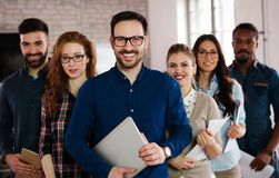 Group picture of team of successful and confident designers. In office Royalty Free Stock Photo