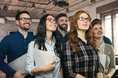 Group picture of young successful team of designers stock images