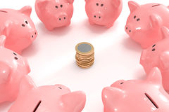 Group of piggy banks looking at a pile of coins Royalty Free Stock Photography