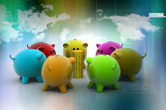 Group of piggybanks around with gold coins Royalty Free Stock Image