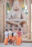 Hindus dressed in orange clothes stands in front of Narasimha. The group of pilgrims - the Hindus dressed in orange clothes stands in front of Narasimha`s Stock Photo
