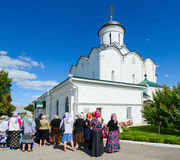 Group of pilgrims near Cathedral of Assumption of Holy Dormition Stock Photos
