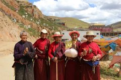 A group of pilgrims smiling to the camera during their way. A group of pilgrims smiling to the camera. Taken in Amdo Tibet, China - March 2015 Royalty Free Stock Photo
