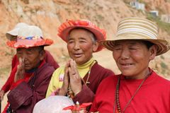 A group of pilgrims smiling to the camera during their way. A group of pilgrims smiling to the camera. Taken in Amdo Tibet, China - March 2015 Stock Photography