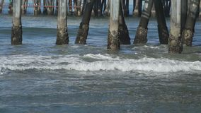 Group of pilings under the Santa Monica Pier. The Santa Monica Pier is a large double-jointed pier located at the foot of Colorado Avenue in Santa Monica stock video