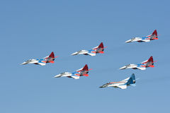 Group pilotage of fighters MIG 29. SAINT- PETERSBURG - JUNE 02 2007: joint demonstration flights of  Russian pilotage groups Strizhi and Russian knights in Stock Image