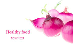 Group pink onion on a white background. Several peeled shiny onion. Isolated. Stock Photos