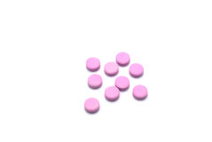 Group of pink pills isolated on white background. Royalty Free Stock Image
