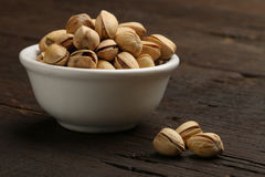 Group of pistachios in a bowl Royalty Free Stock Image