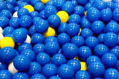 Group of plastic blue, yellow and white balls Stock Photo