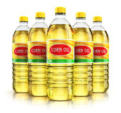 Group of plastic bottles with corn oil Royalty Free Stock Photo
