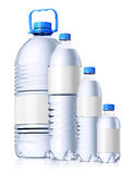 Group of plastic bottles with water. Isolatedon wh. Group of plastic bottle full of water with clear white label for design presentation. Isolated on white Royalty Free Stock Photo