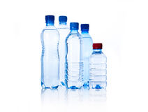 Group plastic bottles of water  on white Royalty Free Stock Photo