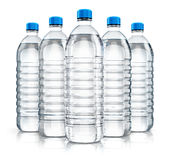 Group of plastic drink water bottles. 3D render illustration of the group of five plastic bottles with clear purified drink carbonated water isolated on white Stock Images