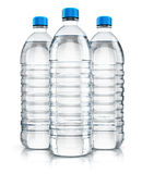Group of plastic drink water bottles. 3D render illustration of the group of three plastic bottles with clear purified drink carbonated water isolated on white Royalty Free Stock Photography
