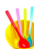 Group of plastic spoons in bowl isolated Stock Photo