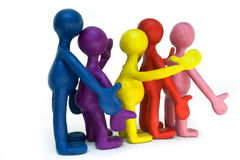 Group of plasticine puppets on white background Stock Photos