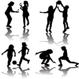 Group of playing children silhouettes Stock Images
