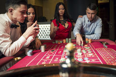 Group Playing Roulette Stock Photo