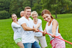 Group playing tug of war. Strong group in a competition playing tug of war royalty free stock photography