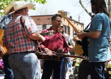 Group plays instruments on street during festival Royalty Free Stock Image
