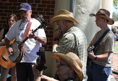 Group plays instruments on street during festival Stock Photography