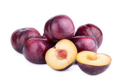Group of plum fruits and a half on white. Background Stock Images