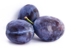 Group of plums. On a white background Royalty Free Stock Photo