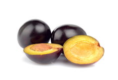 Group of plums  on white. Group of shiny ripe plums  on white Stock Photography