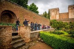 Group pof tourists in Patio de Machuca, Alhambra Royalty Free Stock Images