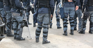 Group of police officers in riot control with batons during  Royalty Free Stock Image