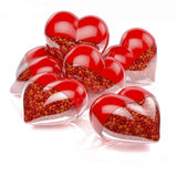 Group, pool of red heart shaped pills, capsules filled with small tiny hearts as medicine. 3d rendering isolated on white, reflecting background stock photography