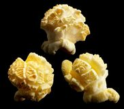 Group of popped popcorn on a black background Royalty Free Stock Photos