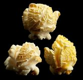 Group of popped popcorn on a black background Royalty Free Stock Photo