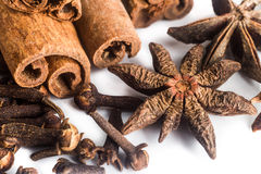 Group of popular spices consisting Cinnamon sticks, Cloves and Star Anise Stock Image