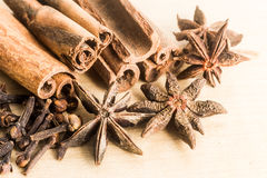 Group of popular spices consisting Cinnamon sticks, Cloves and Star Anise Stock Photos