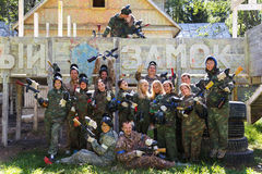 Group portrait of big happy company playing paintball. Outdoors Royalty Free Stock Photo