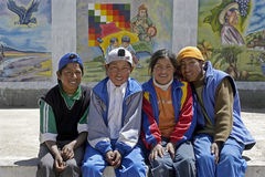 Group portrait of Bolivian teens, Huanuni, Bolivia. Bolivia, village Huanuni: closeup of four Native American young people. youngsters. The boys and the girl stock image